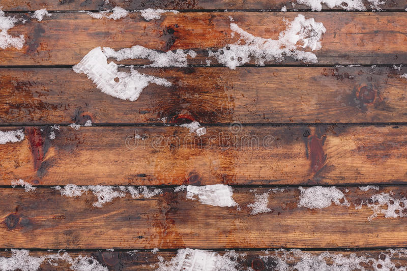 Winter background with wooden floor covered by snow royalty free stock photo