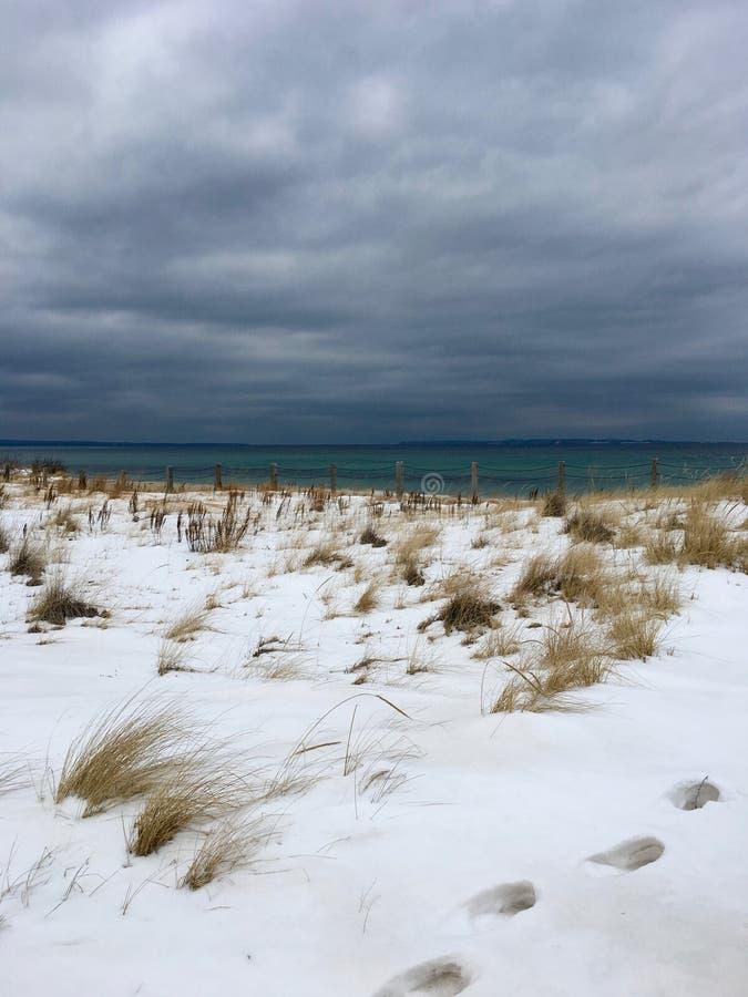 Winter beach on Lake Michigan. stock photo