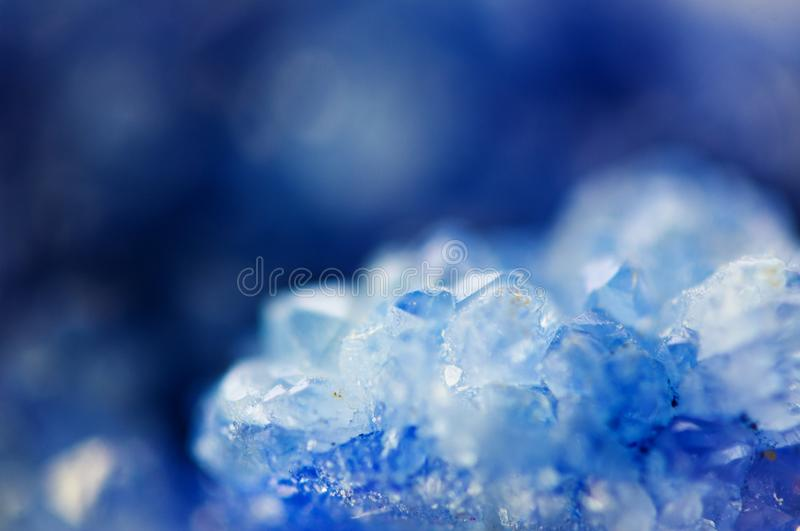 Winter beautiful background of beautiful of blue crystals. Macr royalty free stock image