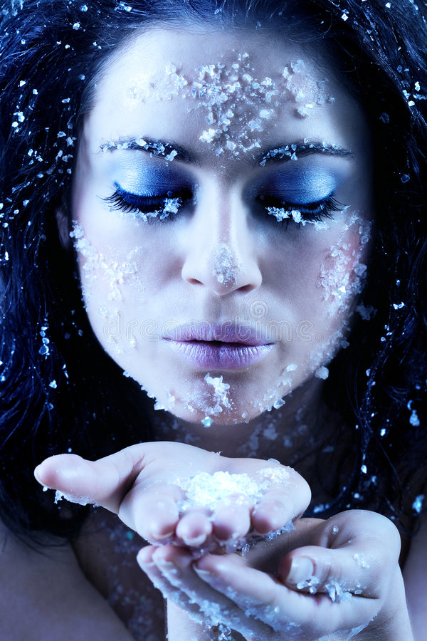 Winter beauty blowing snowflakes stock photo