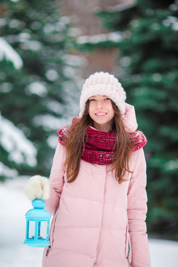 Winter beauty. Woman holding Christmas lantern outdoors on beautiful winter snow day stock image