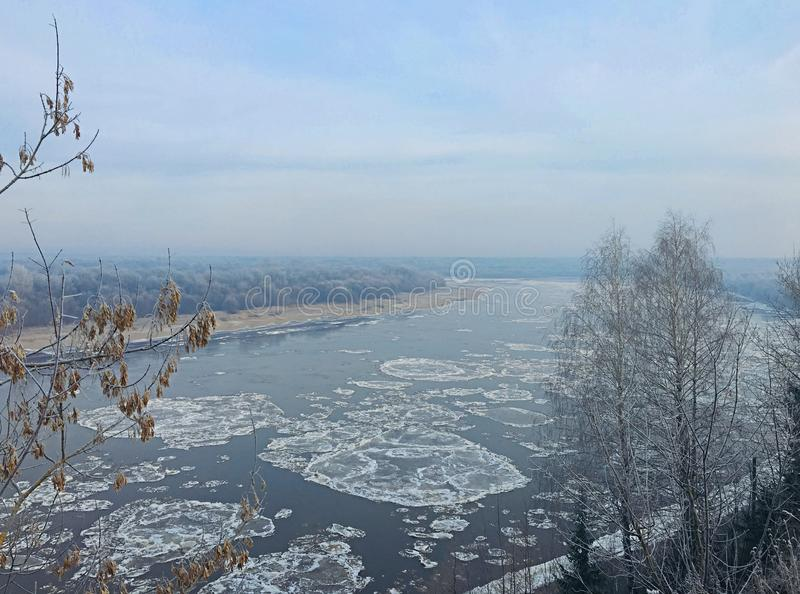 Winter begins and the river is covered with ice. Nice winter begins and the river is covered with ice stock photo
