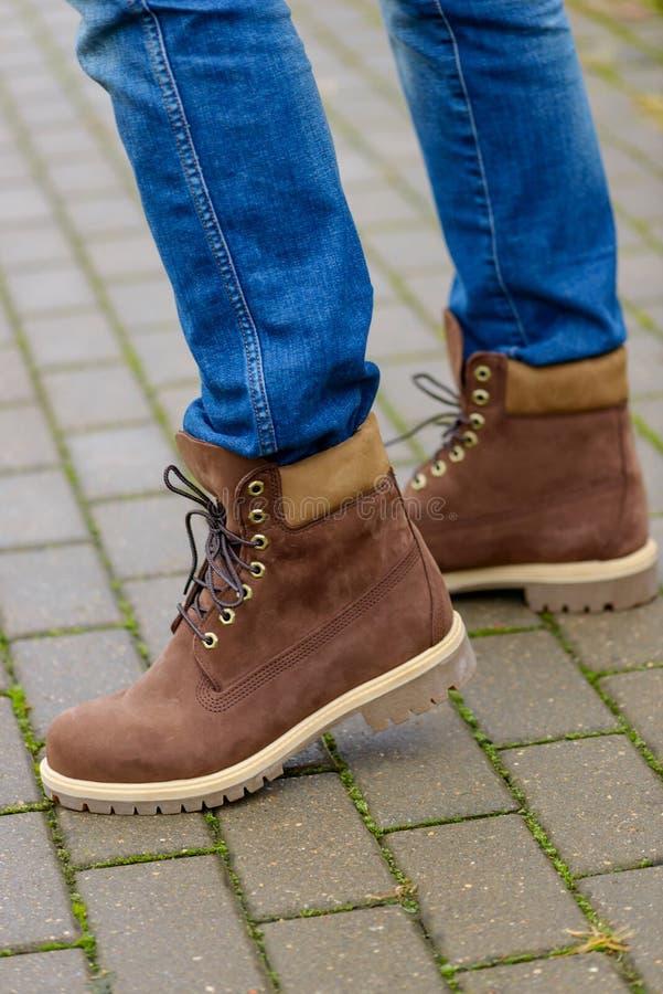Winter boots on men`s legs stock image