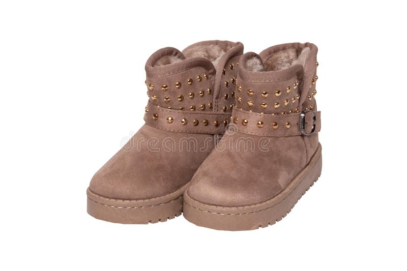 Winter boots. A pair brown suede leather winter boots and lined royalty free stock image