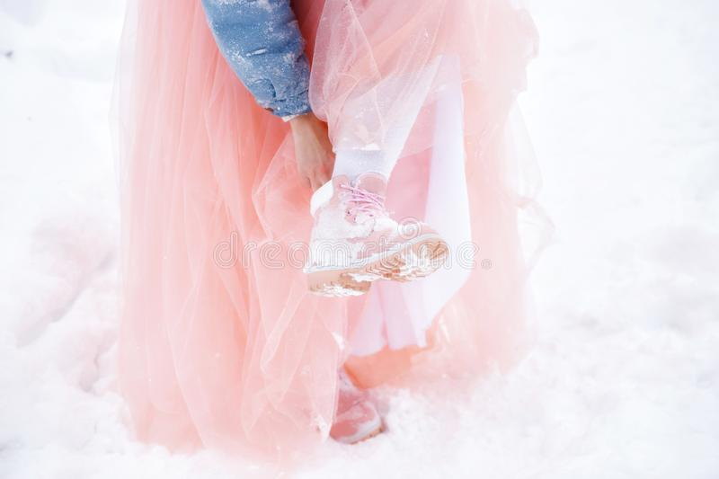 Winter boots in the snow. pink womens winter boots royalty free stock photos