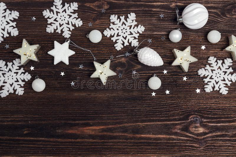 Winter border of holiday decorations with copy space on wooden b. Ackground. Top view, flat lay stock photo
