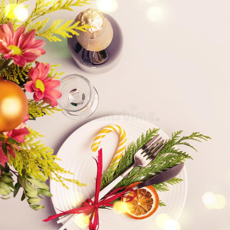 Winter bouquet, natural decoration and bokeh lights. Christmas table setting.  stock photo