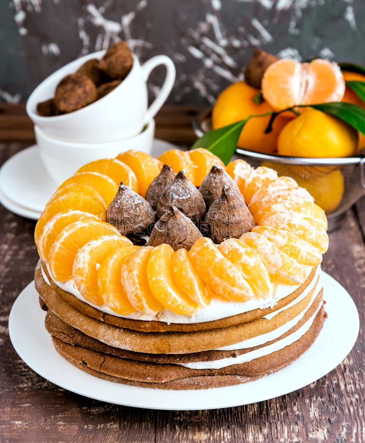 Winter cake with Mandarin. Homemade cake with fruits and candy stock images