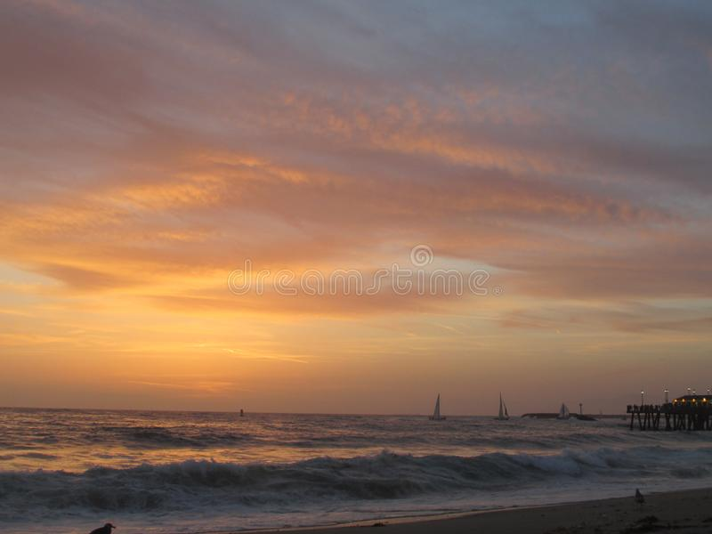 Winter Candy Skies. Beautiful winter skies and Wavey beach stock images