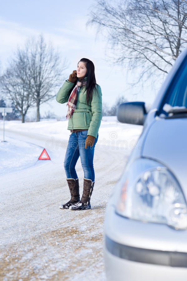 Winter car breakdown - woman call for help royalty free stock photography