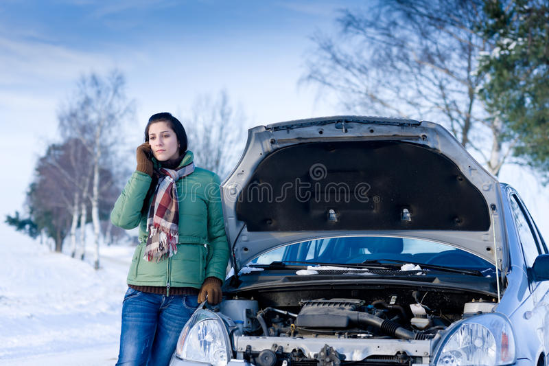 Winter car breakdown - woman call for help royalty free stock images