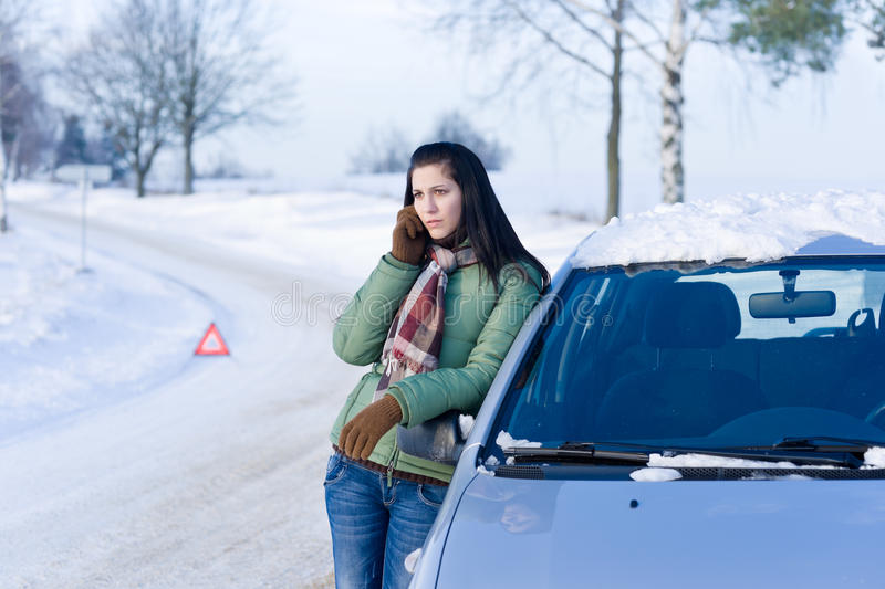 Winter car breakdown - woman call for help stock photography