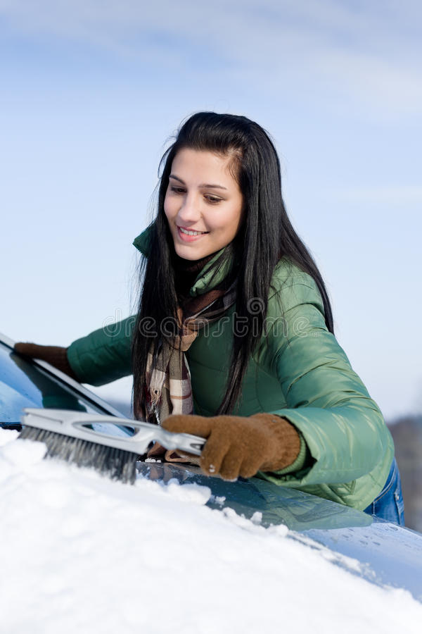 Download Winter Car - Woman Remove Snow From Windshield Royalty Free Stock Image - Image: 17426666