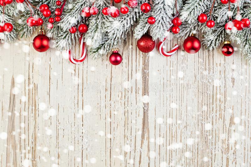 Winter card background. Red Christmas decoration on white wooden royalty free stock images