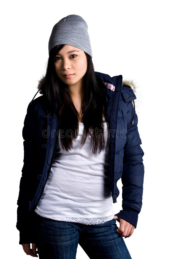 Winter casual wear. A model wearing a jacket and jeans royalty free stock image