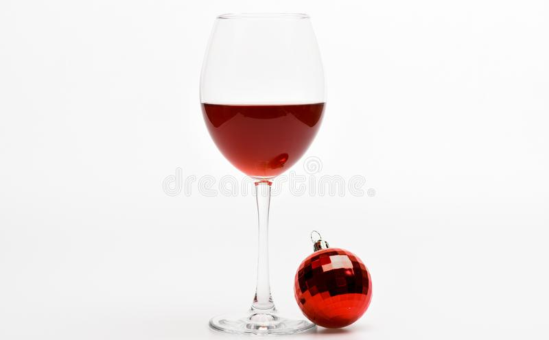 Winter celebration with alcohol drink. New year party concept. Glass with wine and christmas decoration. Wineglass with stock images