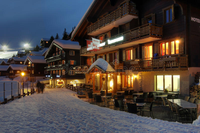 Winter chalet hotel in Switzerland. Hotel and winter resort scene in Bettmeralp, Switzerland at night royalty free stock photo