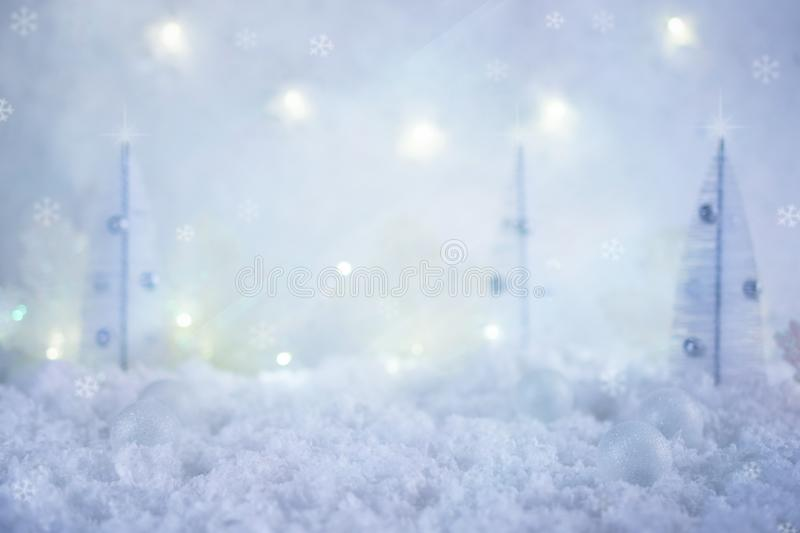 Winter Christmas background.Merry Christmas and happy New Year greeting card with snowy toy fir trees and copy space. stock photo