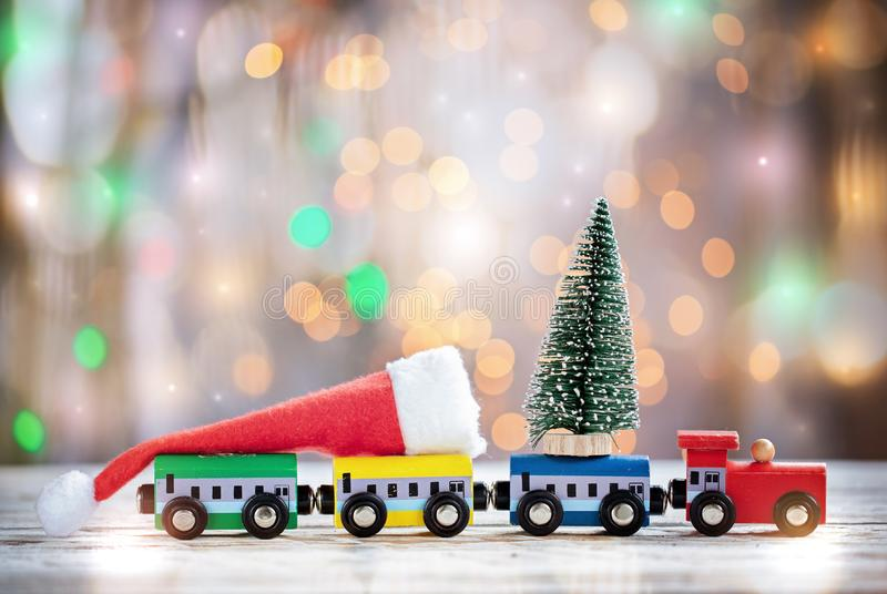 Winter Christmas background Miniature colorful train with fir tree. Holiday greeting card stock photo
