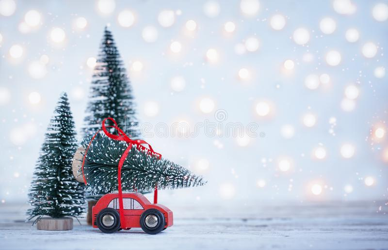 Winter Christmas background Miniature red car with fir tree. Holiday greeting card royalty free stock photos