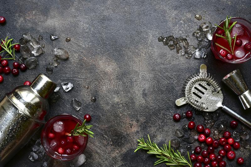 Winter christmas cocktail with cranberry and rosemary in a glasses. Top view with copy space royalty free stock photography