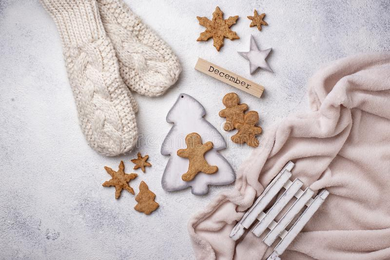 Winter Christmas composition with gingerbread cookies royalty free stock images