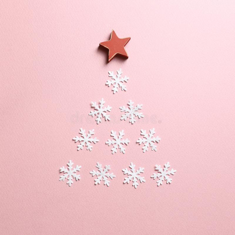 Winter Christmas concept. Snow tree on pink background. Top view stock photo