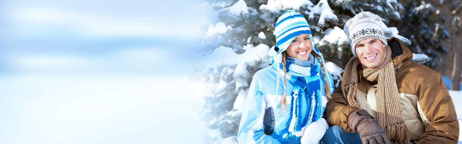 Winter christmas couple. Happy loving couple enjoying in winter park with snow stock photos