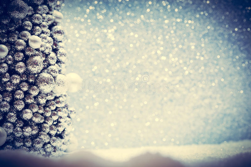 Winter Christmas decoration. Snow, glitter and Christmas tree ornament. royalty free stock photos