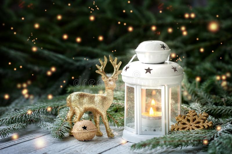 Christmas decoration with lantern, gold snowflake and balls, fir branches and ornaments on dark background stock photos