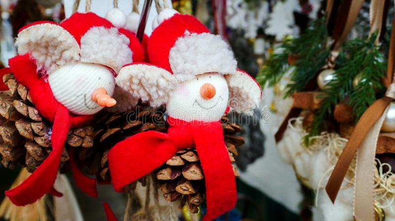 Winter Christmas Decorations made of small stuffed Men with Red Hat and Scarf on a Pine Cone royalty free stock photos