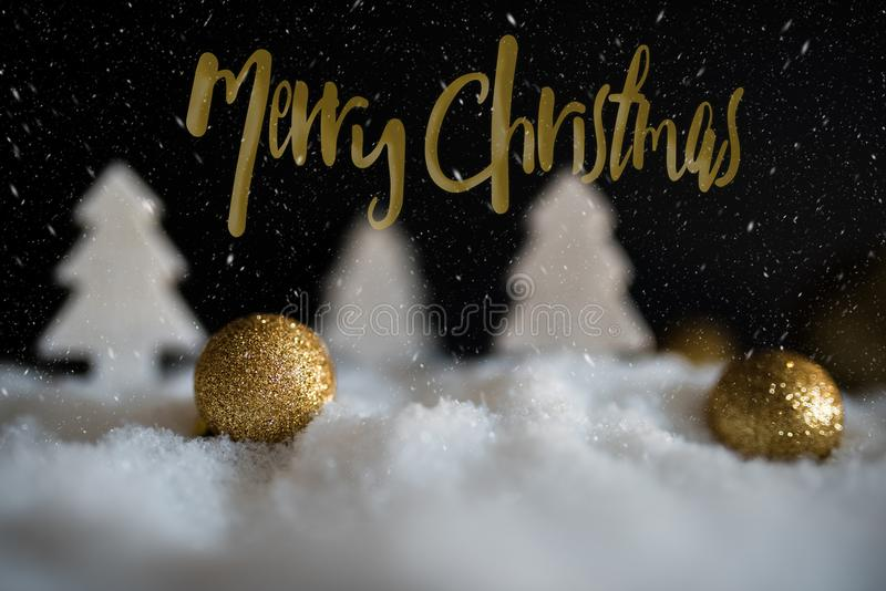 Winter christmas greeting card with golden christmas tree ornaments royalty free stock photography