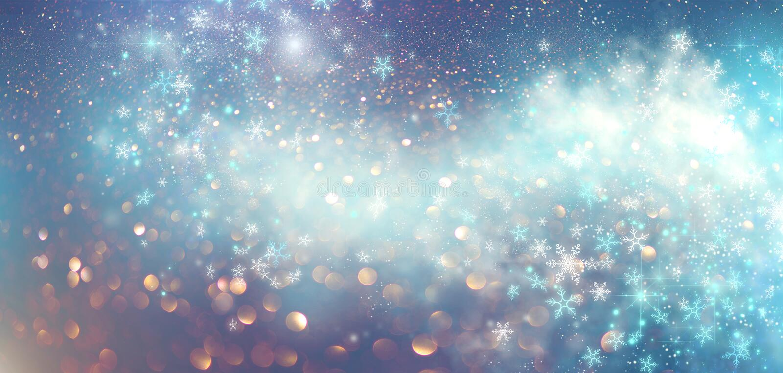 Winter Christmas and New Year glittering snow flakes swirl bokeh background, backdrop with sparkling blue stars, holiday garland. Magic glowing stars, lights royalty free stock photography