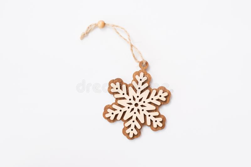Winter,Christmas, New Year wooden decoration - snowflake, star. Isolated on white background.  royalty free stock photo