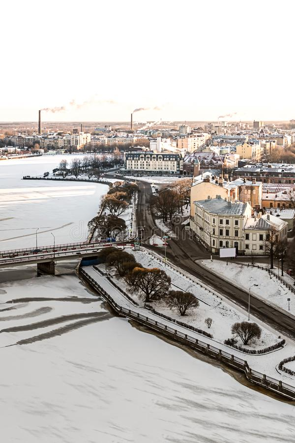 Winter city houses an ancient square contrasted with a modern background along the snow-covered frozen river peninsula panorama vi. Ew of Vyborg. Russia Vyborg royalty free stock photo