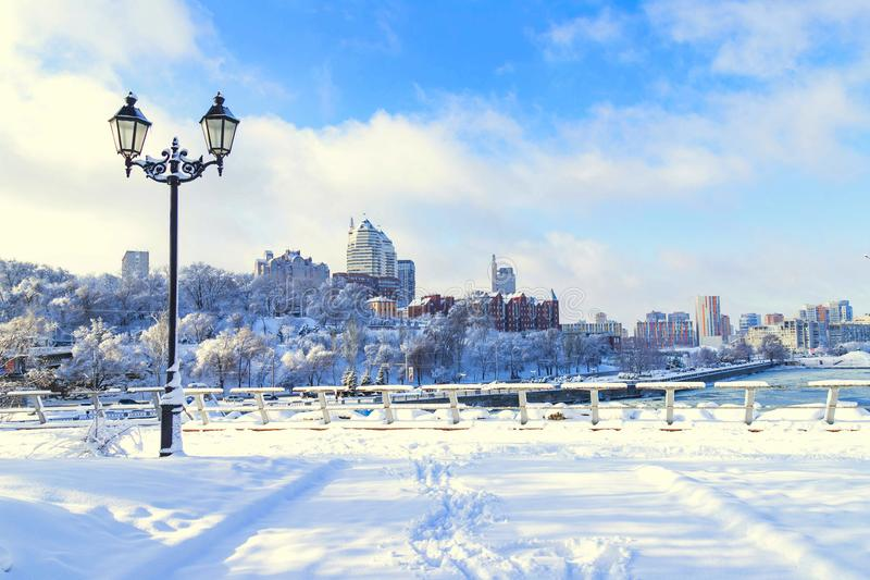 Winter city landscape, covered with snow with a beautiful lantern. View of the buildings, skyscrapers and towers,Ukraine royalty free stock photo