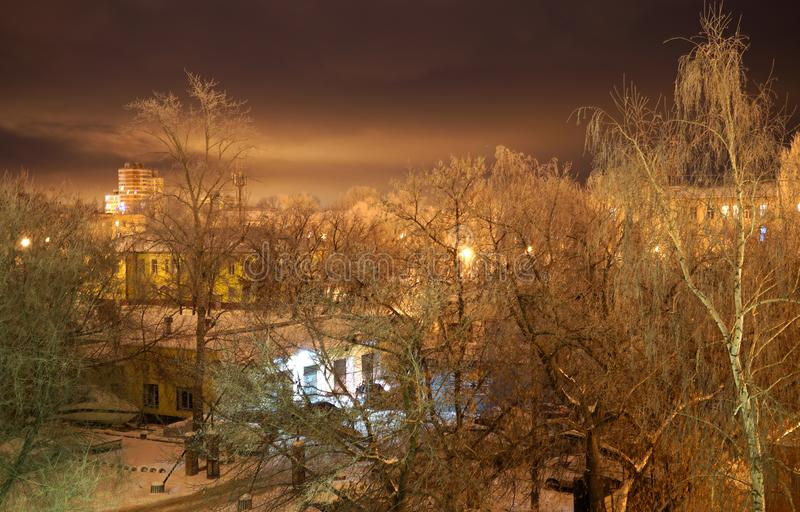 Winter in the city. Night snowbound city stock photography