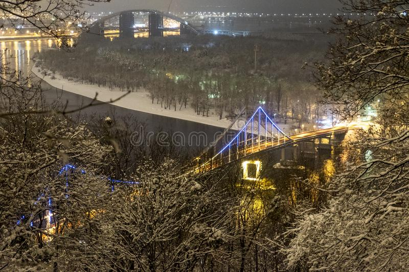 Evening Kyiv. View from the hill over the Dnieper river on Pedestrian bridge and Trukhanov island. Kyiv, Ukraine stock images