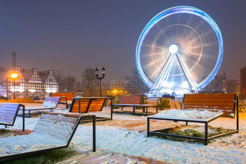 Winter cityscape of Gdansk at dusk with ferris wheel, Poland. Old beautiful port river town motlawa night landscape snow blue dawn polish light travel snowy stock photography