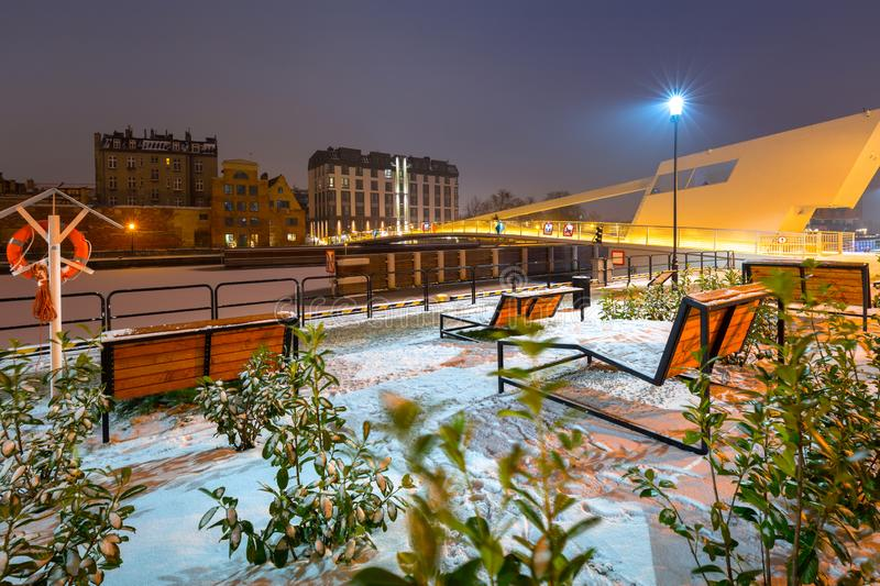 Winter cityscape of Gdansk at dusk, Poland. Old beautiful port river town motlawa night landscape snow blue dawn polish light travel snowy architecture tourism stock images