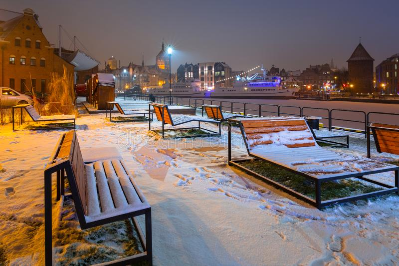 Winter cityscape of Gdansk at dusk, Poland. Old beautiful port river town motlawa night landscape snow blue dawn polish light travel snowy architecture tourism royalty free stock photo