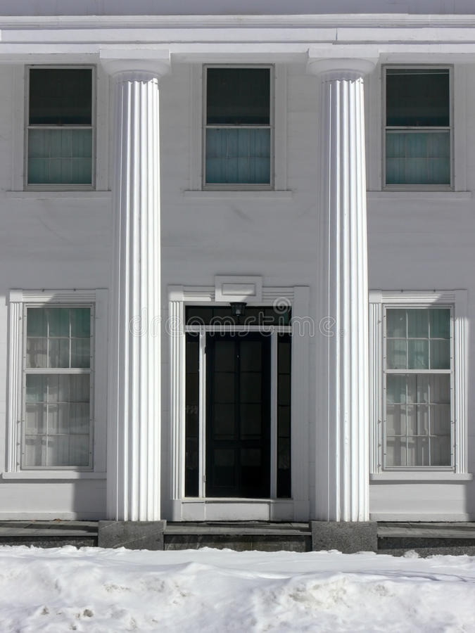 Winter: classical house with columns royalty free stock image