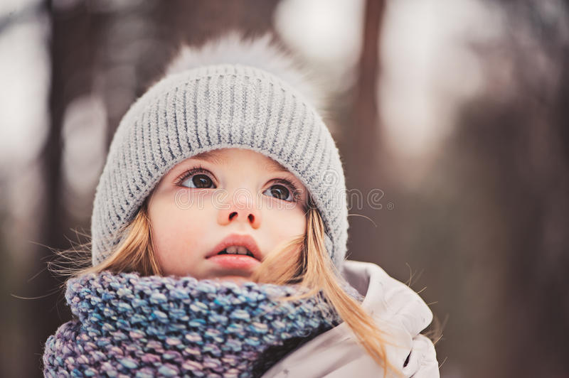Winter close up outdoor portrait of adorable dreamy baby girl royalty free stock photography