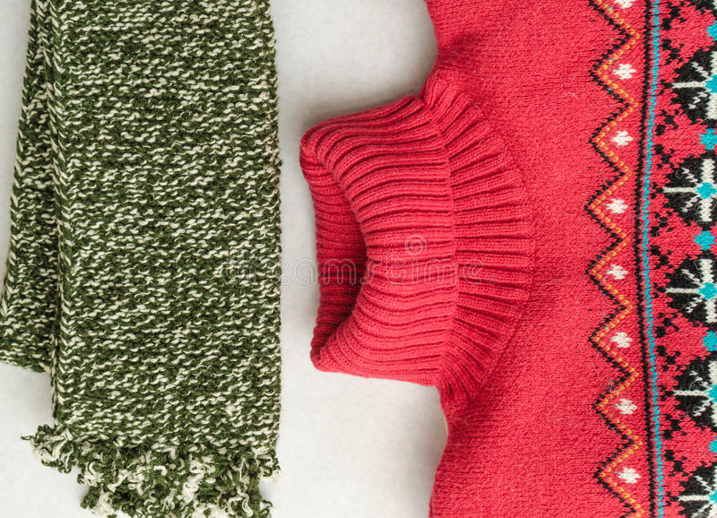 Winter clothes intensely colored wool. Neckcloth and sweater. Winter is coming. Top view stock photo