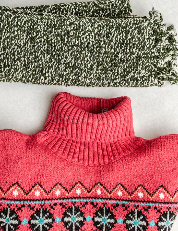 Winter clothes intensely colored wool. Neckcloth and sweater. Winter is coming. Top view royalty free stock image