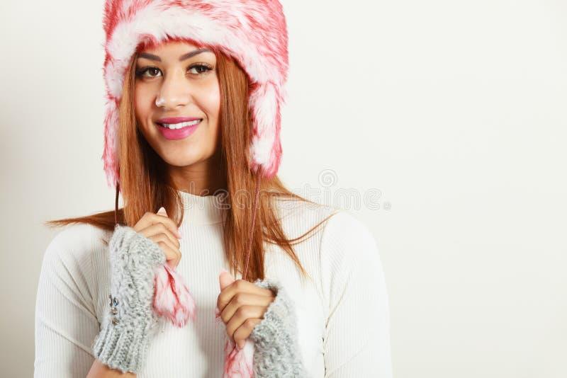 Mulatto woman wearing winter fur cap royalty free stock photos