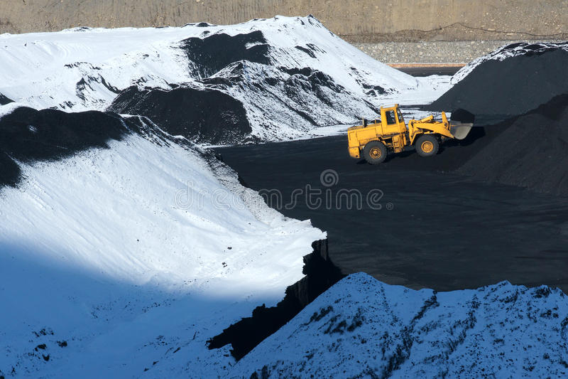 Winter coal-pit. The loading machine are working in winter coal-pit stock images