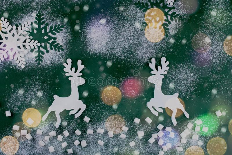 Winter composition with deers and snowflakes. On green background. Christmas card. royalty free stock photography
