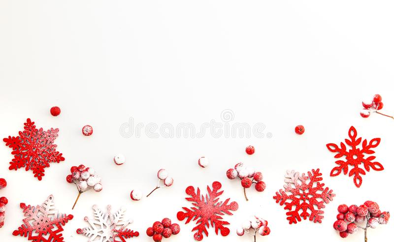 Winter composition. Frame made of snowflakes and red berries Rowan on white isolated background. Christmas, winter, new year royalty free stock images