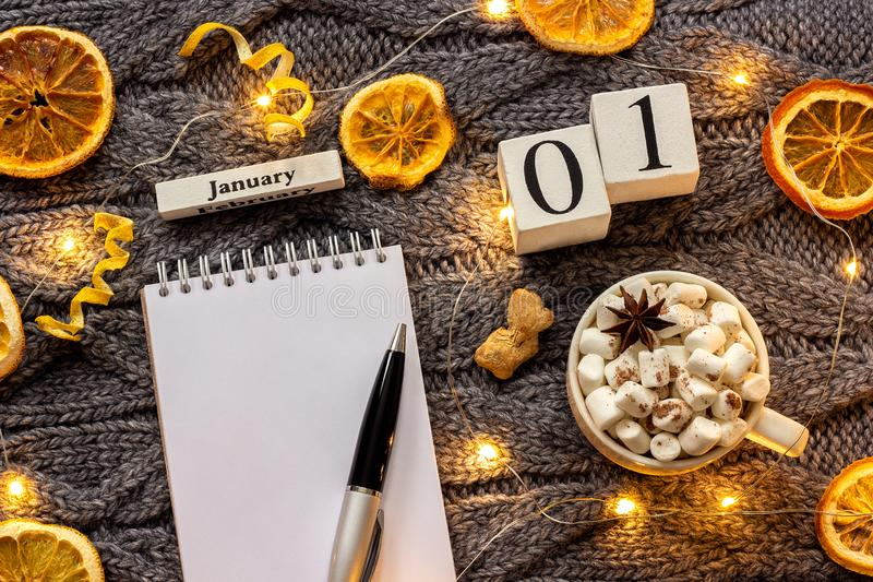 Calendar January 1st Cup of cocoa and empty open notepad royalty free stock photos